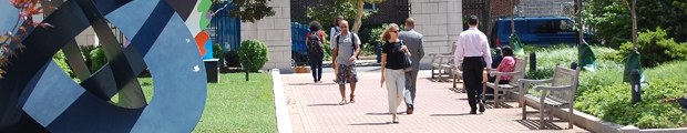 People walking through Kogan Plaza